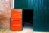 Dokkum, Friesland, Netherlands: Old Red Barn Door in Dokkum, one of the 11 Friesian historic cities.
