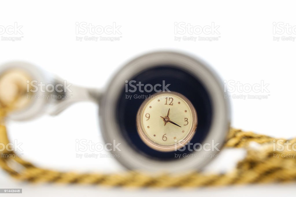 dolden wrist-watch through opera glasses royalty-free stock photo