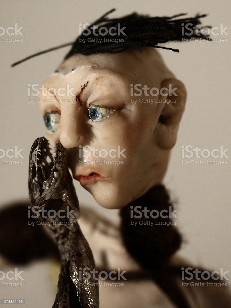 Doll and a dead snake stock photo