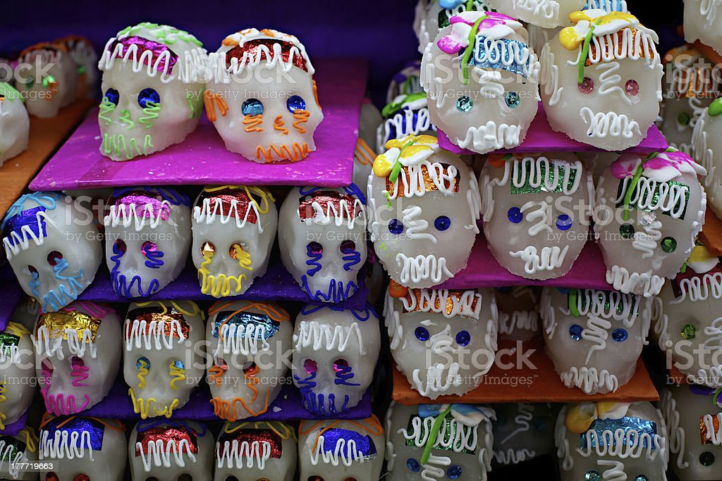 Doll heads and skulls decorated with jewels and paint stock photo