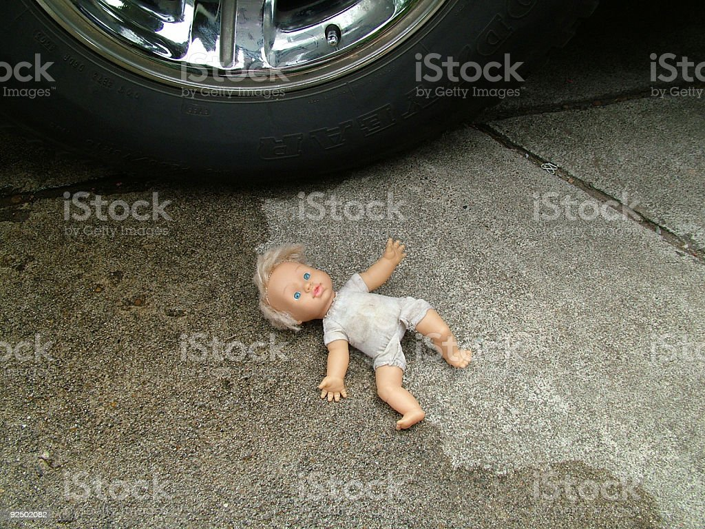 Doll in driveway royalty-free stock photo