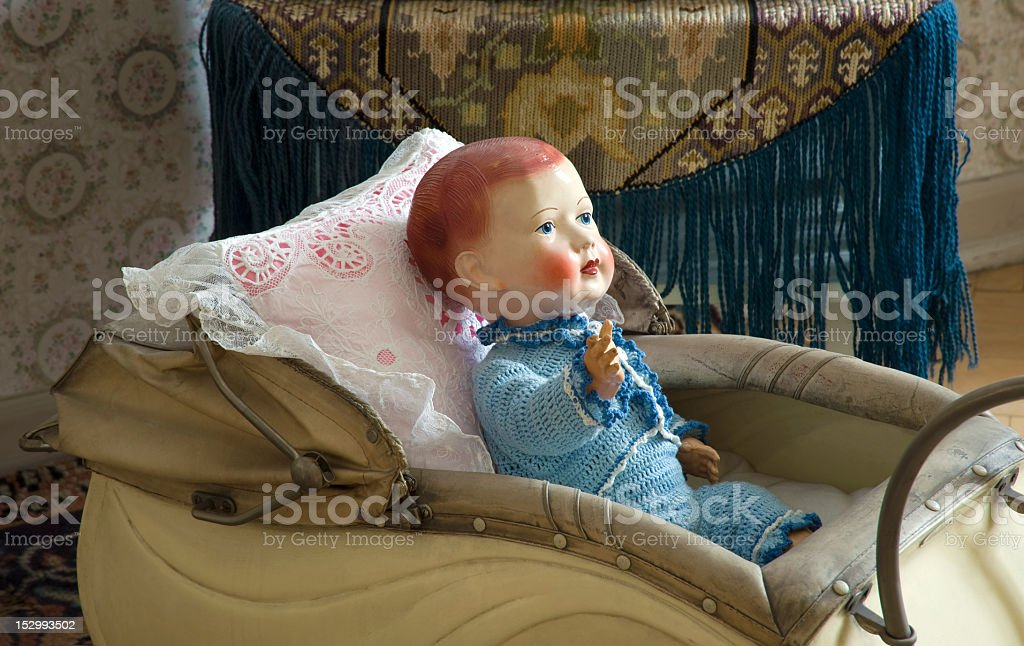 Doll in the baby carriage stock photo