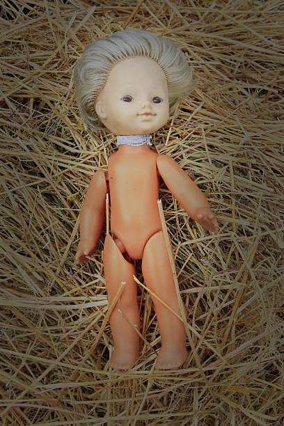 doll lost on the hay - deplorable stock pictures, royalty-free photos & images