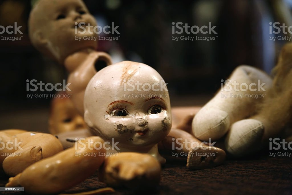 Doll Old and Damaged stock photo