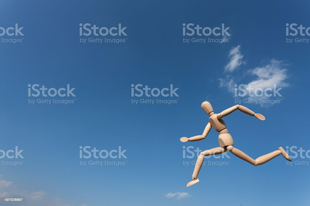 Doll running the sky royalty-free stock photo