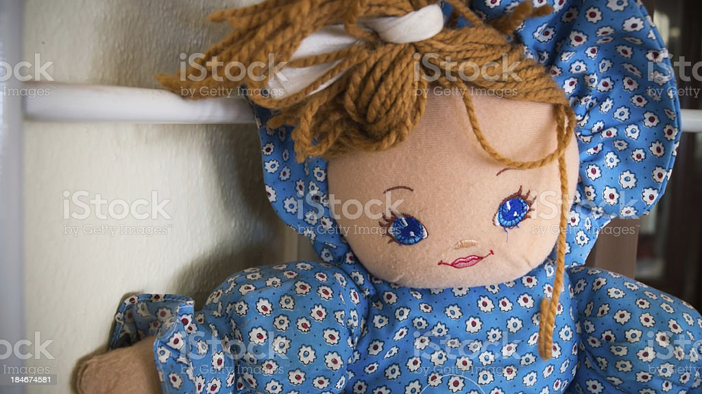 Doll with blue dress stock photo