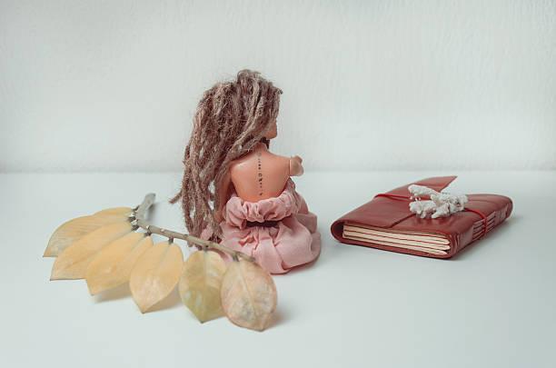 doll with dreadlocks and tattoo with solar system - sternenkinder tattoo stock-fotos und bilder