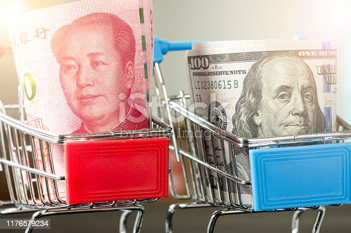 istock US dollar and China Yuan banknote on shopping cart.Its is symbol for tariff trade war crisis between United States of America and China which the biggest economic country in the world. 1176579234
