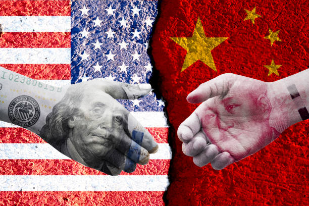 US dollar and China Yuan banknote print screen on handshake with both flags countries.It is symbol of economic tariffs trade war and tax barrier between United States of America and China. US dollar and China Yuan banknote print screen on handshake with both flags countries.It is symbol of economic tariffs trade war and tax barrier between United States of America and China. between stock pictures, royalty-free photos & images