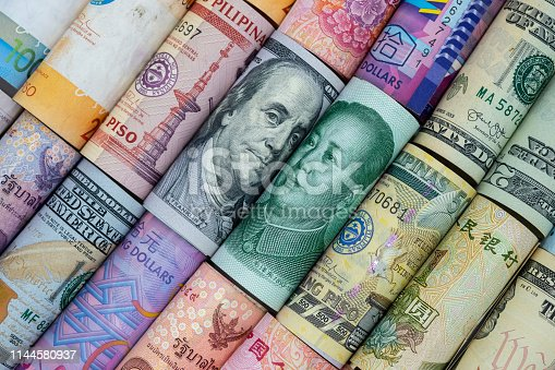 928696036 istock photo US dollar and China Yuan banknote  with multi countries banknotes. Its is symbol for tariff trade war crisis or unfair business of 2 biggest economic countries in the world. 1144580937