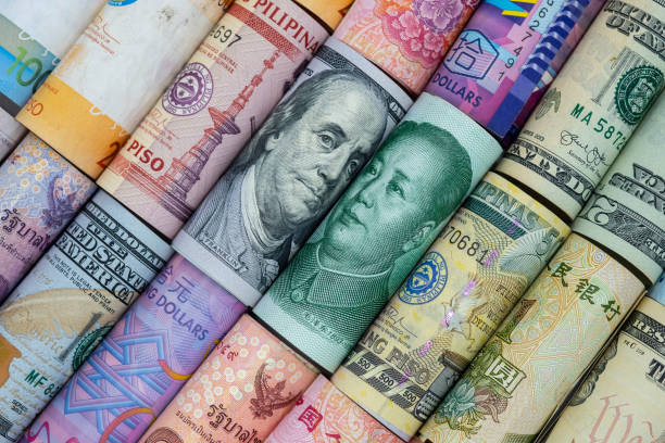 US dollar and China Yuan banknote  with multi countries banknotes. Its is symbol for tariff trade war crisis or unfair business of 2 biggest economic countries in the world. US dollar and China Yuan banknote  with multi countries banknotes. Its is symbol for tariff trade war crisis or unfair business of 2 biggest economic countries in the world. trade war stock pictures, royalty-free photos & images