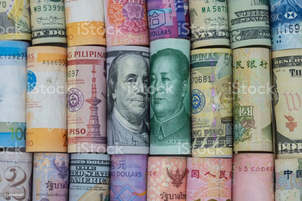 US dollar and China Yuan banknote  with multi countries banknotes. Its is symbol for tariff trade war crisis or unfair business of 2 biggest economic countries in the world. US dollar and China Yuan banknote  with multi countries banknotes. Its is symbol for tariff trade war crisis or unfair business of 2 biggest economic countries in the world. Agreement Stock Photo