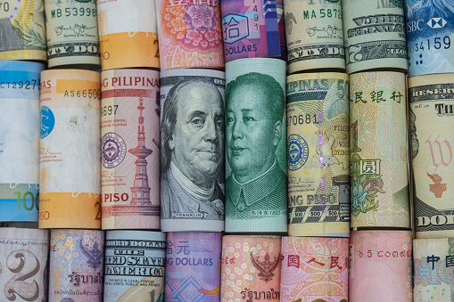 Us Dollar And China Yuan Banknote With Multi Countries Banknotes Its Is Symbol For Tariff Trade War Crisis Or Unfair Business Of 2 Biggest Economic Countries In The World Stock Photo - Download Image Now