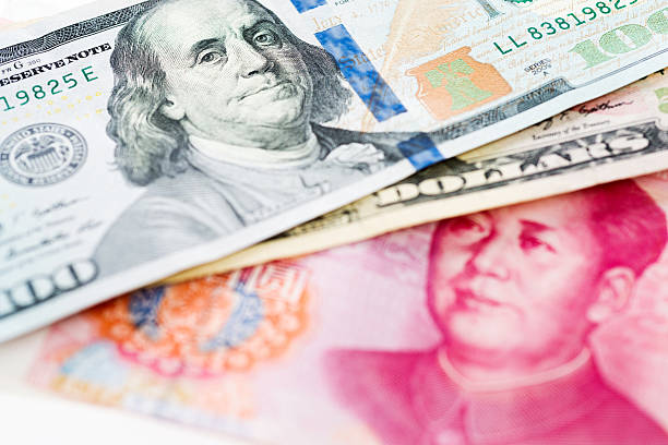 US dollar and China yuan US dollar and China yuan closeup. chinese currency stock pictures, royalty-free photos & images