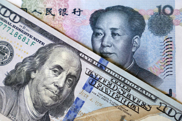US dollar and chinese yuan notes Concept of trade war between China and USA, economic sanctions, trading and investment trade war stock pictures, royalty-free photos & images