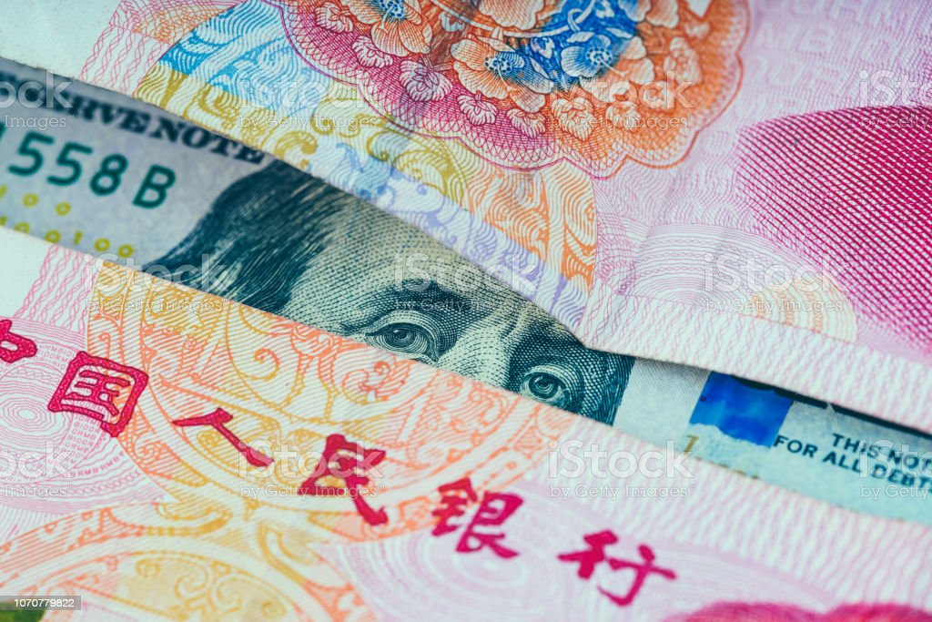 100 US dollar and Chinese Yuan stock photo