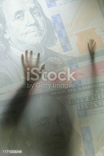 100 US dollar and Chinese Yuan and with back lit man pushing wall