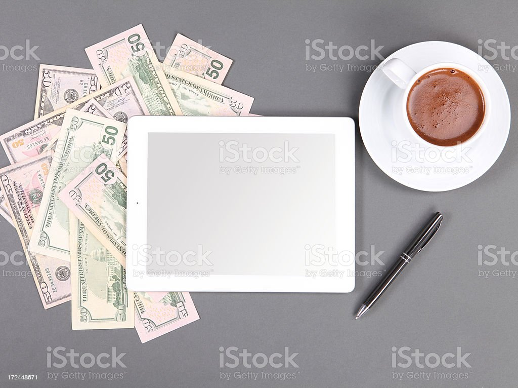Dollar and Digital Tablet royalty-free stock photo