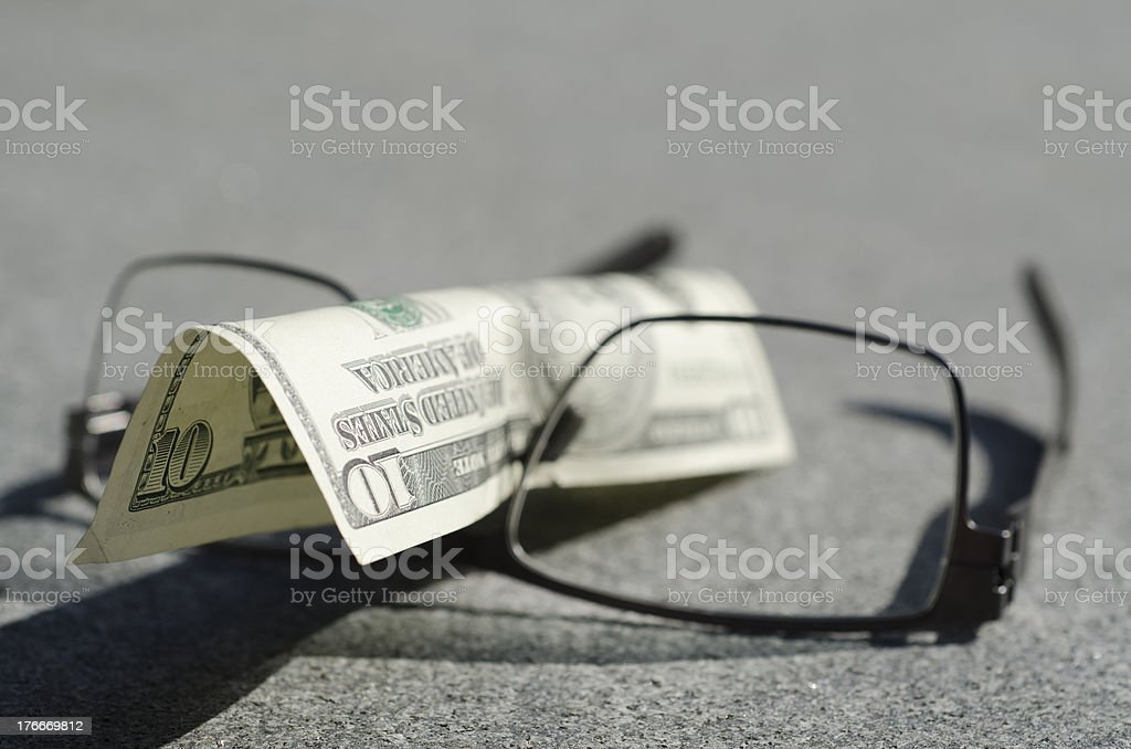 Dollar and eyeglasses royalty-free stock photo