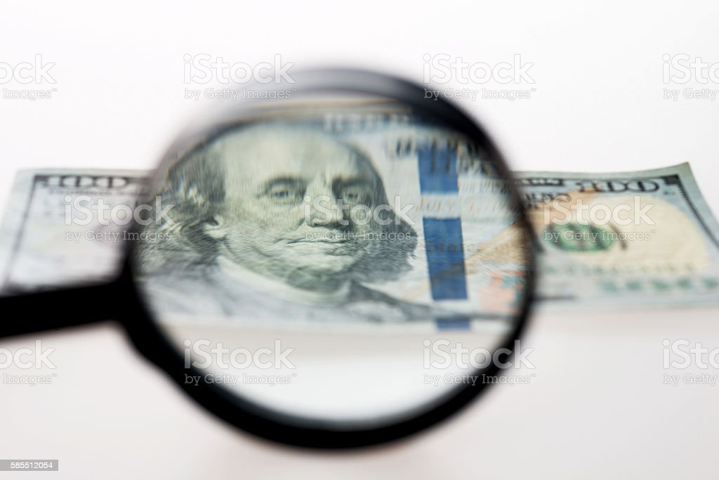 Dollar and magnify stock photo