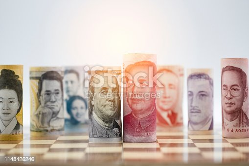 istock US dollar and Yuan banknote on chessboard for trade war between United States and China which both countries battle by increase tax barrier of import and export product. Government and business. 1148426246