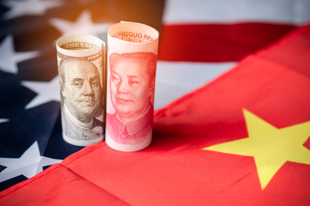 US dollar and Yuan banknote on USA and China flags. Its is symbol for tariff trade war crisis between United States of America and China which the biggest economic country in the world. US dollar and Yuan banknote on USA and China flags. Its is symbol for tariff trade war crisis between United States of America and China which the biggest economic country in the world. trade war stock pictures, royalty-free photos & images