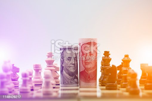 istock US dollar and Yuan banknote with chess for tariff trade war between United States and China which both countries battle by increase tax barrier of import and export product. Government and business. 1148426217