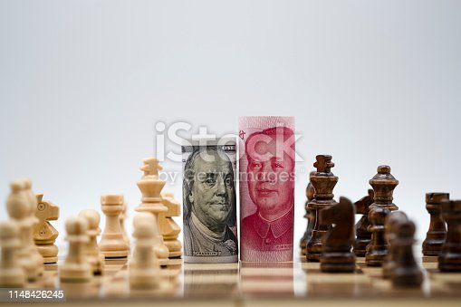 928696036 istock photo US dollar and Yuan banknote with chess for tariff trade war between United States and China which both countries battle by increase tax barrier of import and export product. Government and business. 1148426245