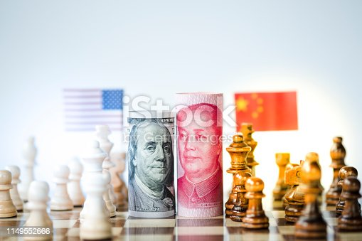 928696036 istock photo US dollar and Yuan banknote with chess for tariff trade war between United States and China which both countries battle by increase tax barrier of import and export product. Government and business. 1149552666