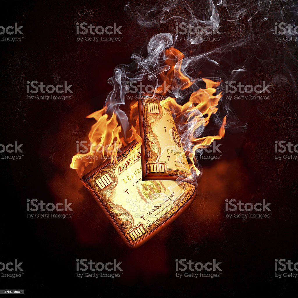 Dollar banknote in fire flames royalty-free stock photo