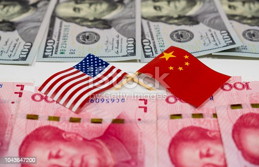 istock USA dollar banknotes and China Yuan banknotes with across of United states of America flag and China flag for the biggest economic country 1043647200