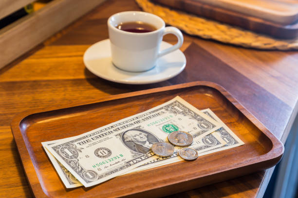 Dollar banknotes and coins,  money tips. stock photo