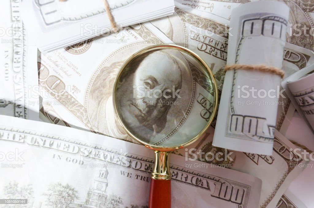 Dollar Banknotes And Magnifying Glass Financial Investigation And  Observation Stock Photo - Download Image Now
