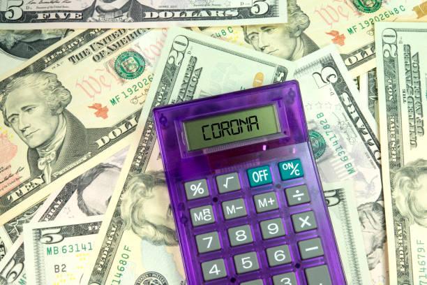 Dollar banknotes, calculators and Corona virus stock photo
