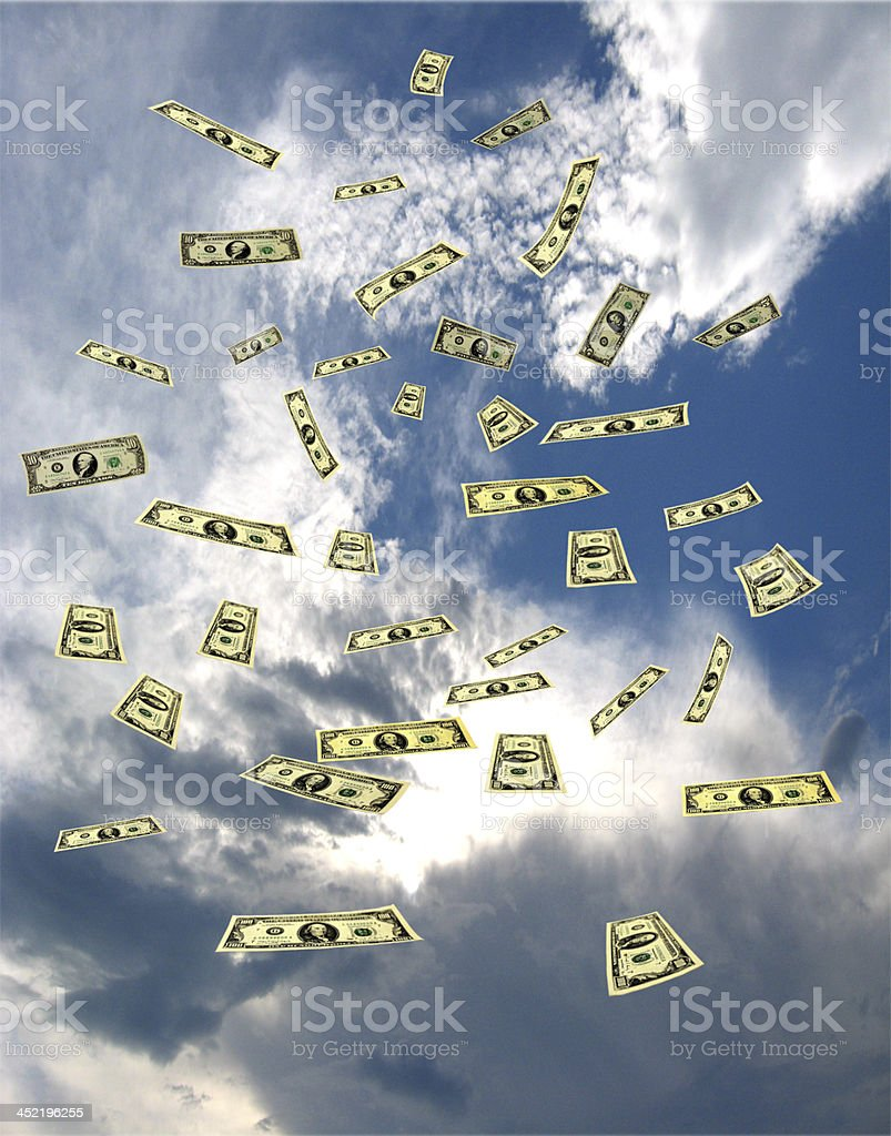 dollar banknotes flying away in the sky royalty-free stock photo
