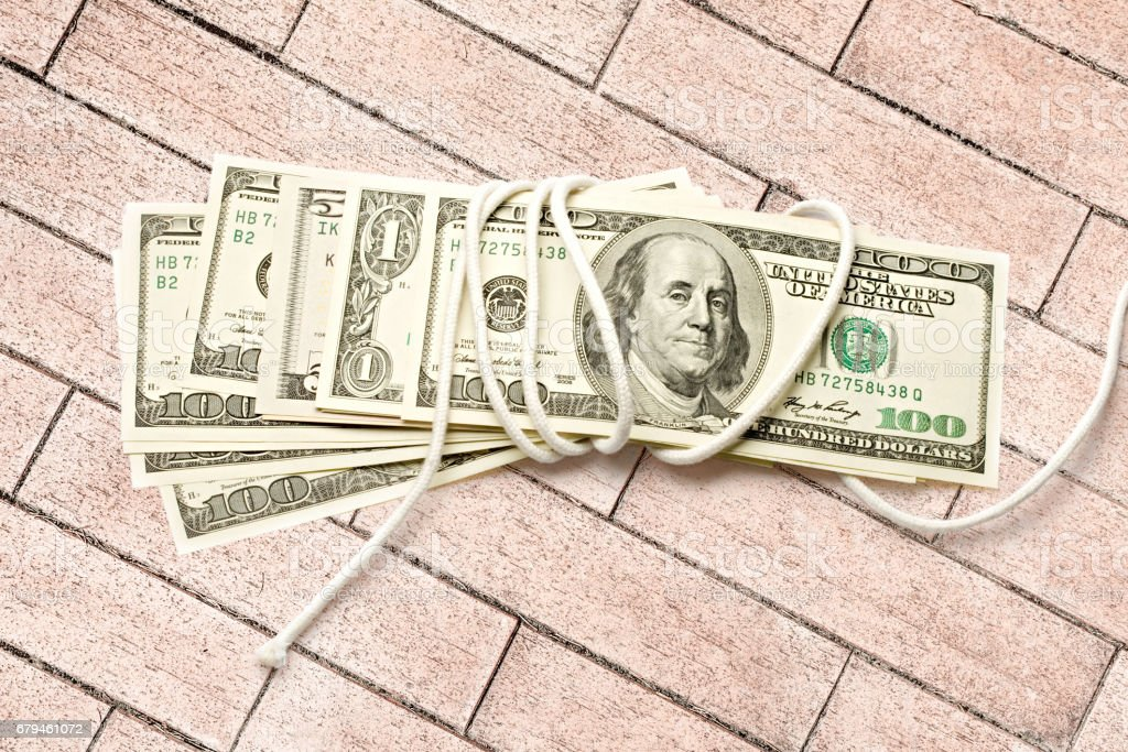 Dollar banknotes wrapped with white rope royalty-free stock photo