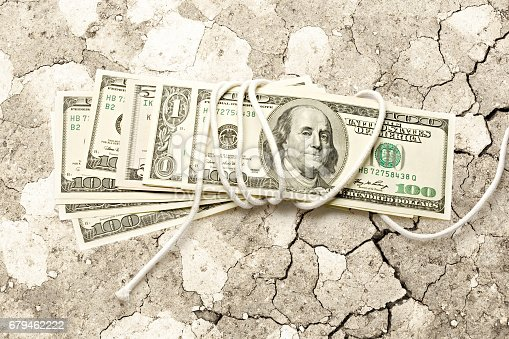 istock Dollar banknotes wrapped with white rope 679462222