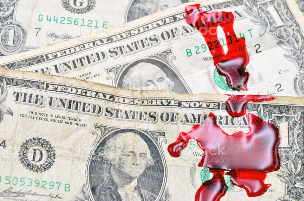 Dollar bill and blood stock photo