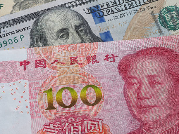 US dollar bill and China yuan banknote macro, Chinese and USA economy finance trade business, money closeup, forex concept. US dollar bill and China yuan banknote macro, Chinese and USA economy finance trade business, money closeup, forex concept. chinese currency stock pictures, royalty-free photos & images