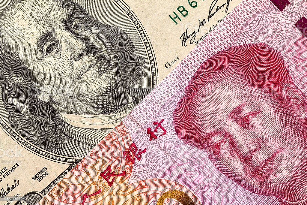 US dollar bill and China yuan banknote macro stock photo