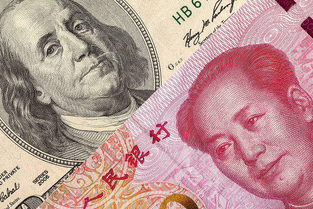 US dollar bill and China yuan banknote macro US dollar bill and China yuan banknote macro, Chinese and USA economy finance trade business, money closeup chinese currency stock pictures, royalty-free photos & images