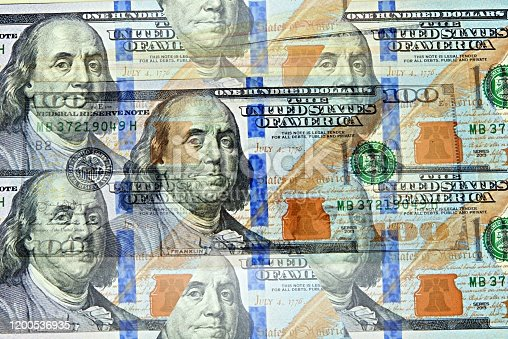 istock 100 dollar bill in multiple background effect. Success concept 1200536935