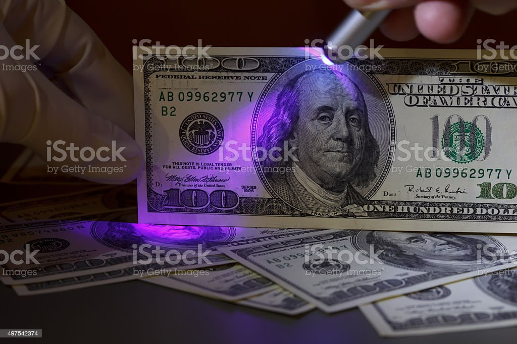 Dollar bill in uv light stock photo