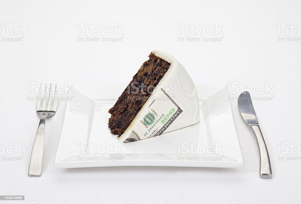Dollar bill printed on slice of cake stock photo