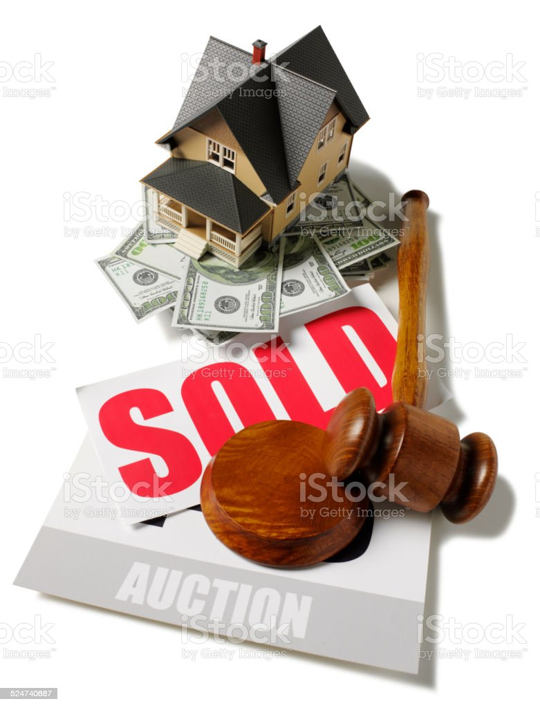 100 Dollar Bills a Toy House and a Auction Gavel stock photo
