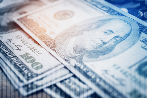 istock Dollar bills and finance and banking on digital stock market financial exchange 910730068