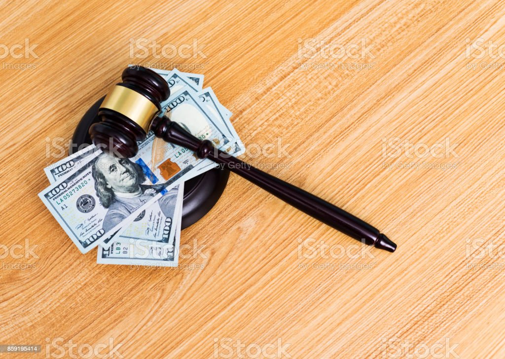 US dollar bills and gavel on the table stock photo