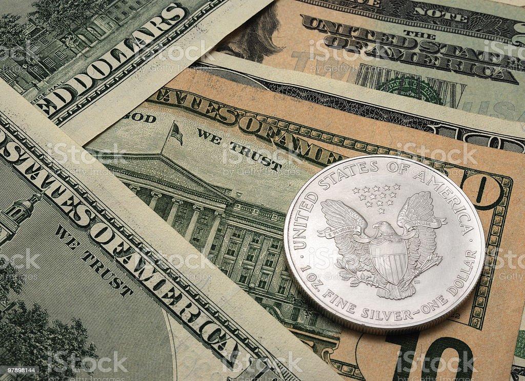 Dollar bills and silver dollar. royalty-free stock photo