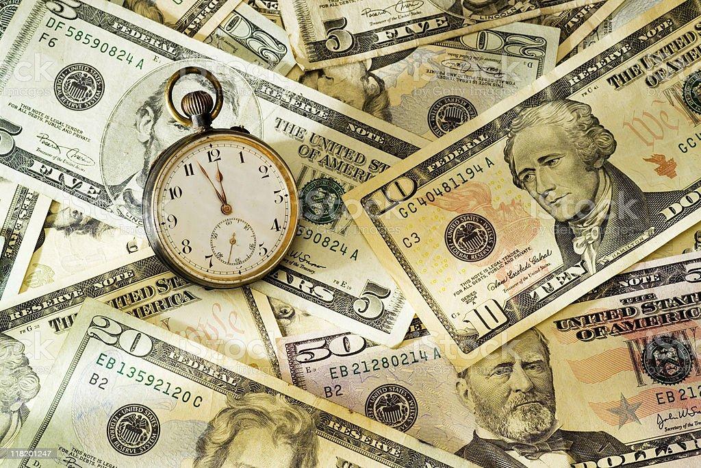 Dollar bills and stopwatch royalty-free stock photo