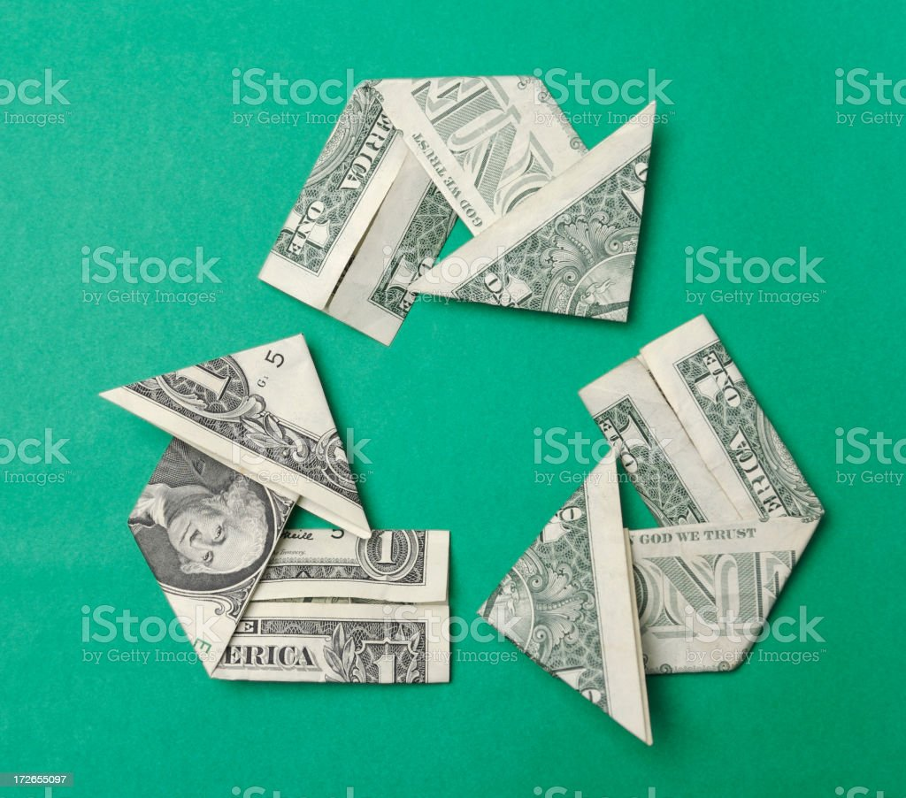 Dollar Bills Folded into Origami Arrows Recycle Symbol royalty-free stock photo